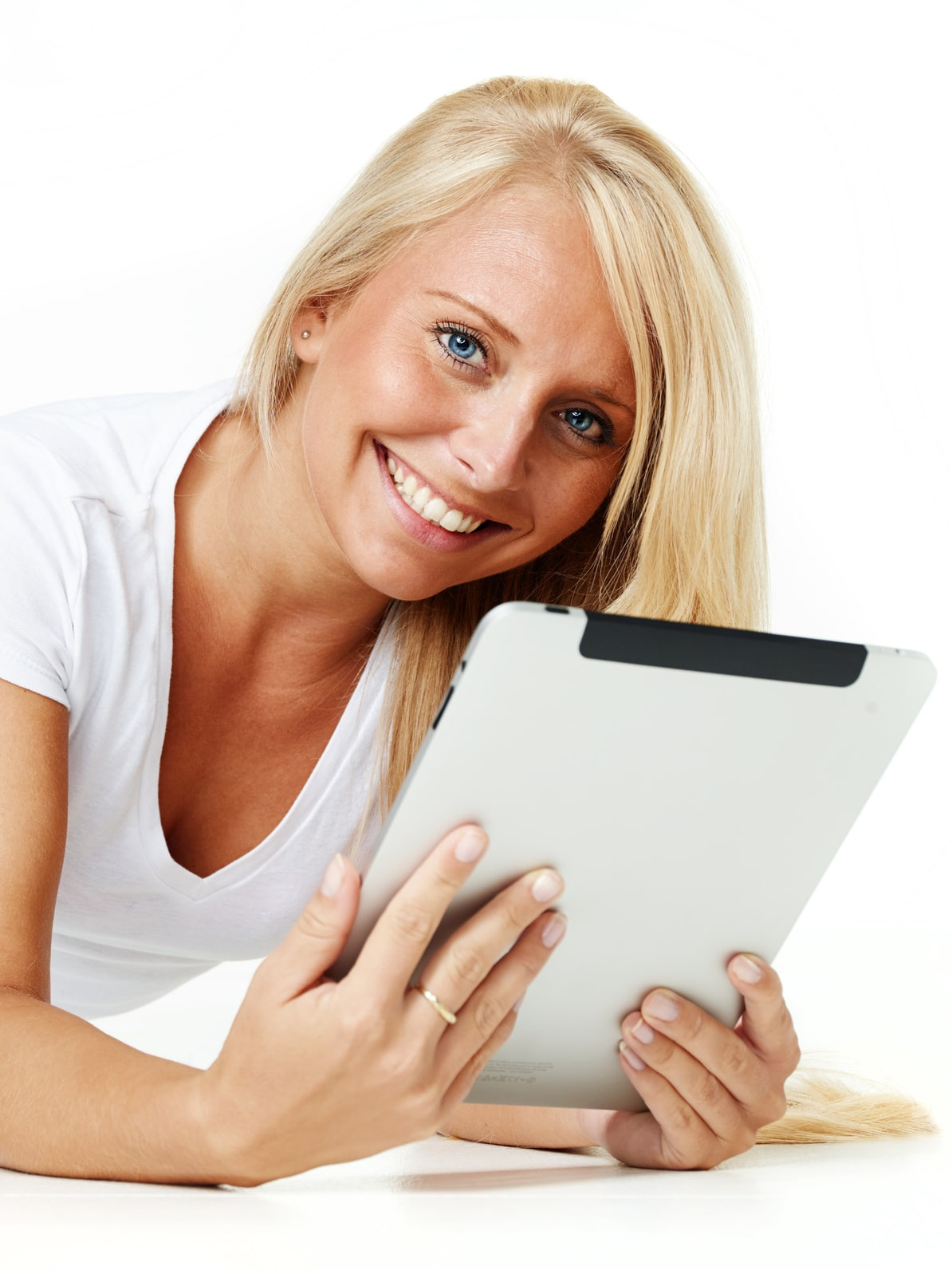Nice women working with tablet pc on the floor